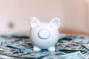 Piggy moneybox with dollar cash closeup