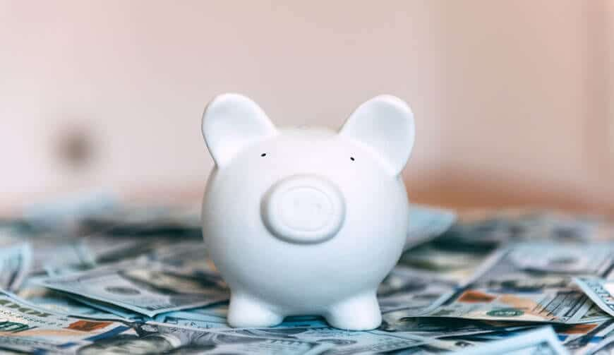 Piggy moneybox with dollar cash closeup
