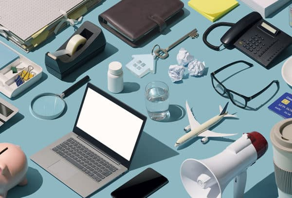 Messy cluttered business desktop with assorted isometric objects: disorganized workstation concept